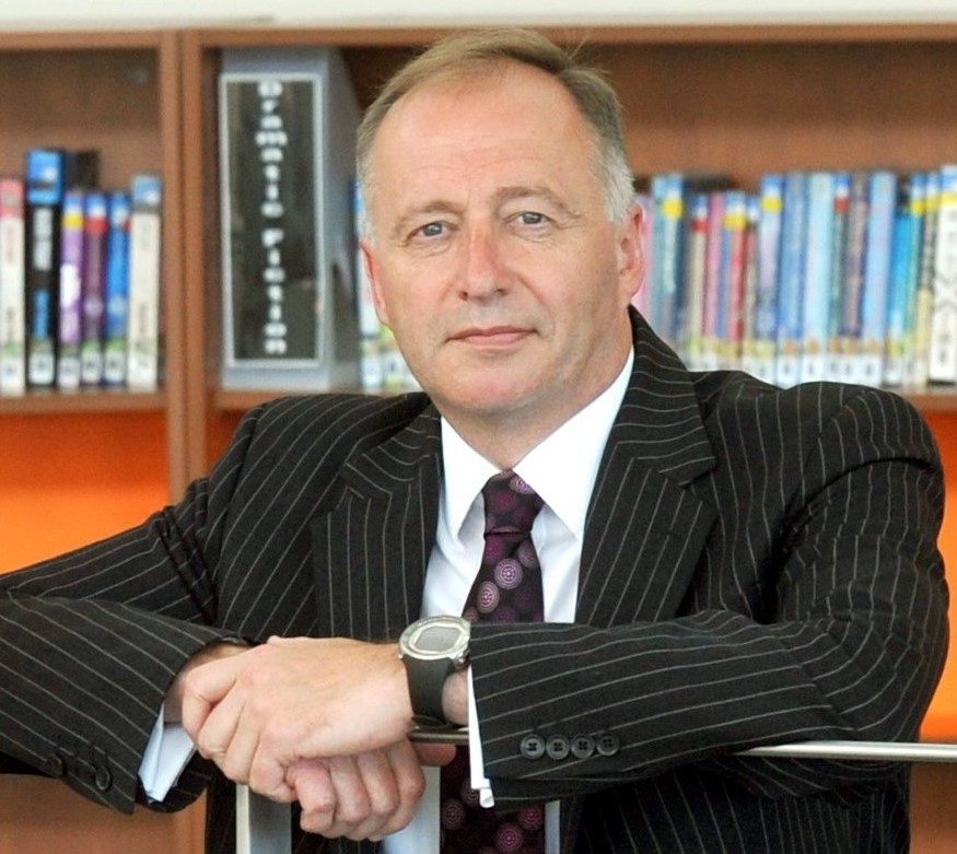 Delta CEO, Paul Tarn in a library